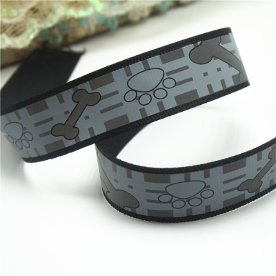 Printed grosgrain reflective ribbon black paw prints